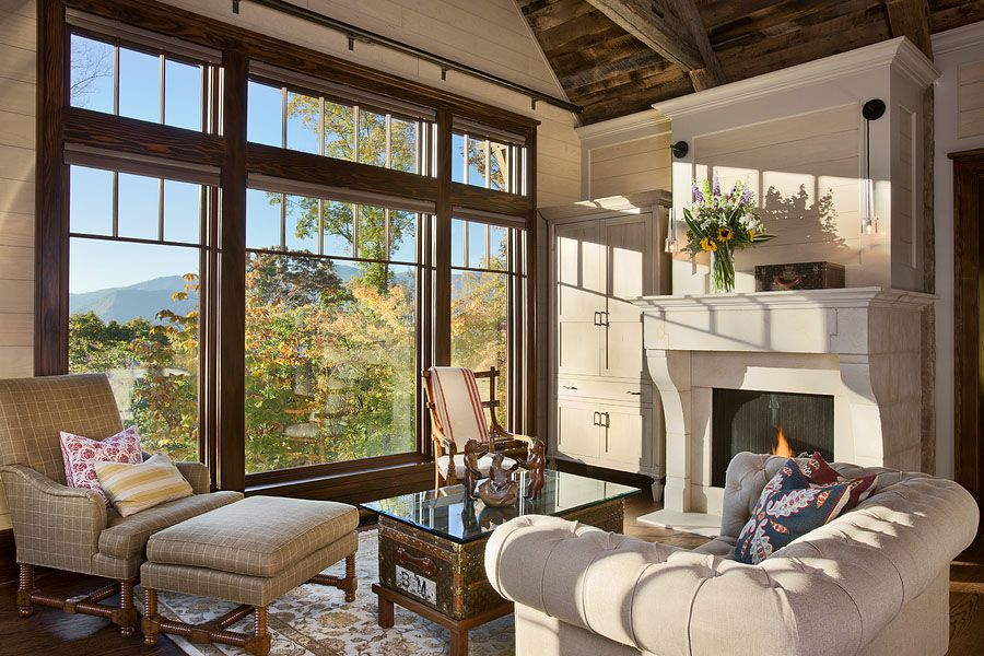 Eclectic Master Bedroom with picture window, Hardwood floors, Pendant light, Exposed beam, Fireplace, Built-in bookshelf