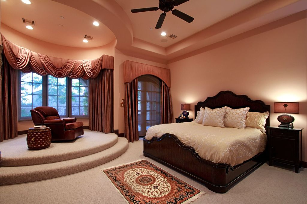 Traditional Master Bedroom with bedroom reading light, Ceiling fan, High ceiling, French doors, can lights, Carpet, Casement