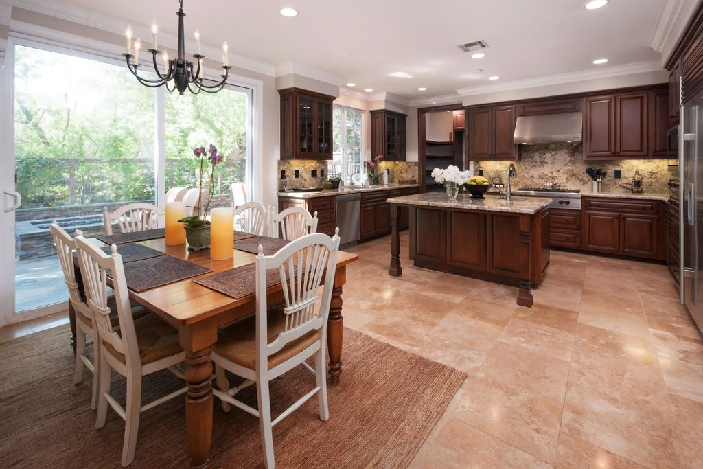 Traditional Kitchen with Wolf Gas Rangetop, Undermount sink, Crown molding, High ceiling, Breakfast nook, Flush, Raised panel