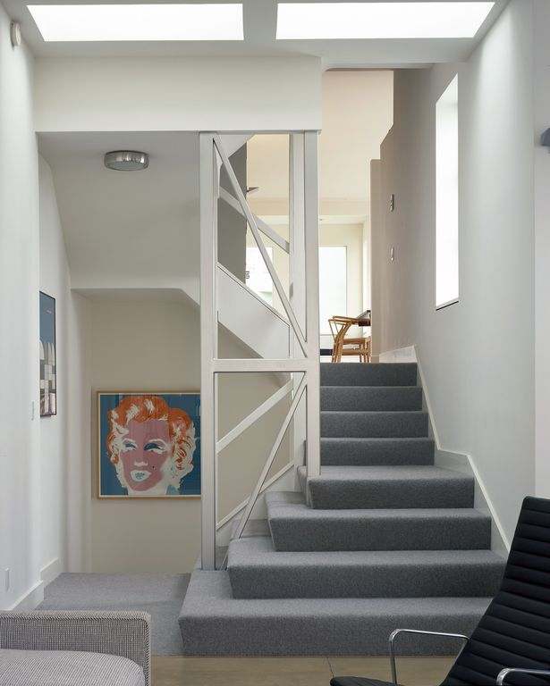 Contemporary Staircase with Standard height, Skylight, curved staircase, Carpet