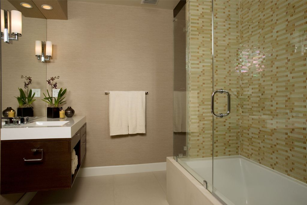 Contemporary Full Bathroom with Wall sconce, can lights, Flush, Shower, stone tile floors, frameless showerdoor, Bathtub