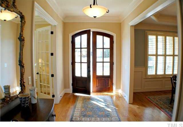Traditional Entryway with Hardwood floors, Standard height, Crown molding, French doors, Pendant light