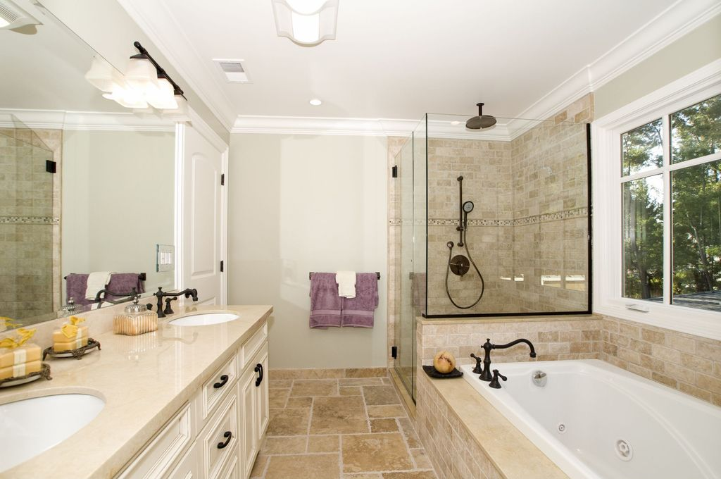 Traditional Full Bathroom with Standard height, specialty door, Handheld showerhead, Torreon stone tumbled travertine tile