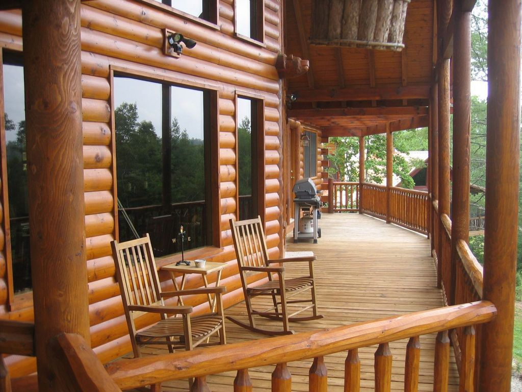 Rustic Porch with Wrap around porch, picture window, Outdoor kitchen, Deck Railing