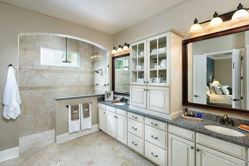 Traditional Master Bathroom with Simple Granite, linen and towel storage cabinet, Shower, picture window, Undermount sink