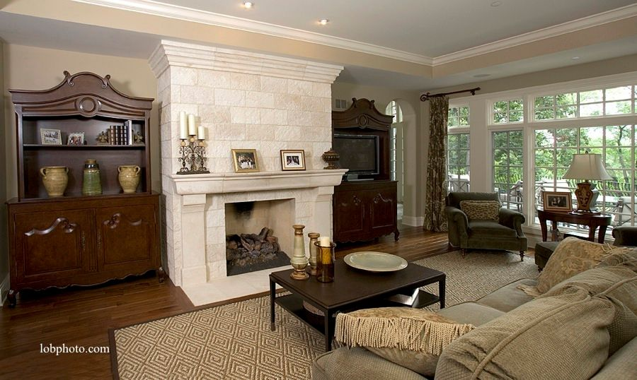 Traditional Living Room with Crown molding, Standard height, Built-in bookshelf, Casement, Fireplace, can lights