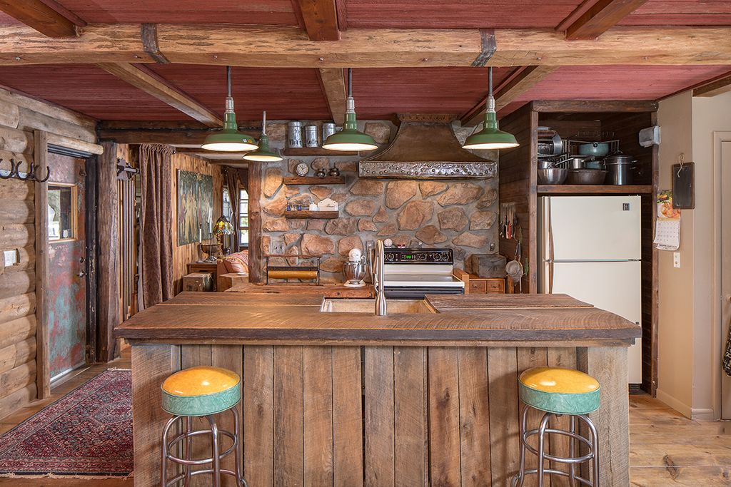 rustic kitchen with custom hood hardwood floors in
