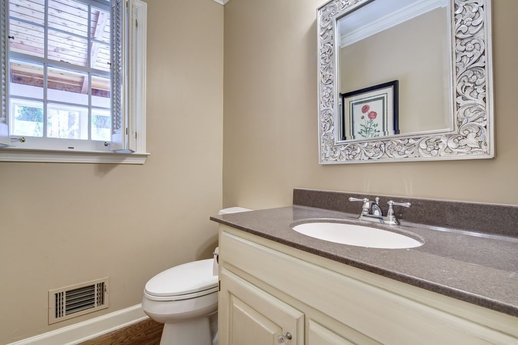 Traditional Powder Room with partial backsplash, Simple granite counters, Powder room, Standard height, Raised panel