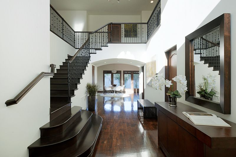 Traditional Staircase with Hardwood floors, High ceiling, curved staircase