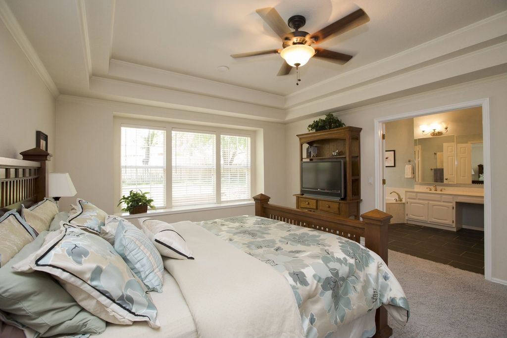 Traditional Master Bedroom with can lights, Crown molding, Ceiling fan, double-hung window, Standard height, Carpet