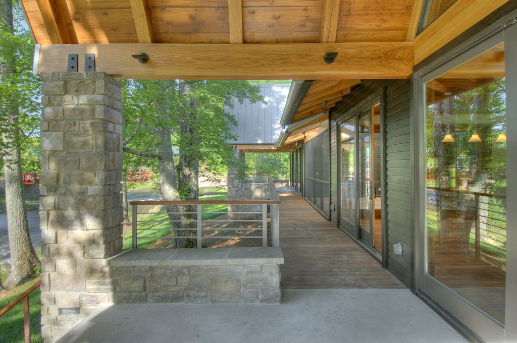 Rustic Porch with exterior tile floors, Wrap around porch, Pathway