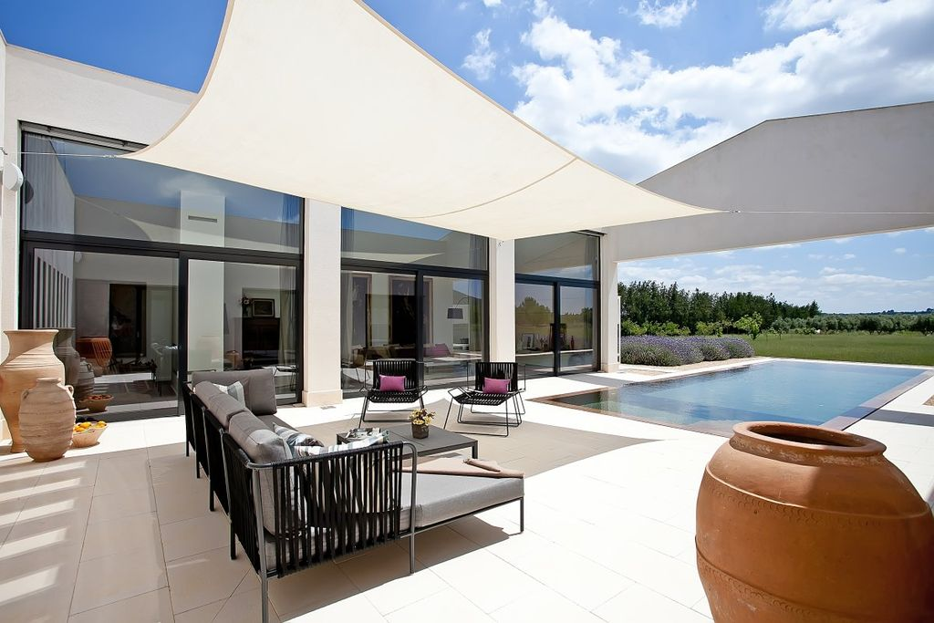 Modern Patio with sliding glass door, exterior tile floors, Lap pool, Transom window, Pathway, picture window