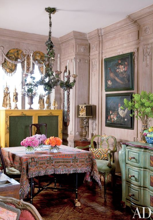 Eclectic Dining Room with Casement, Hardwood floors, Crown molding, Standard height, Chair rail