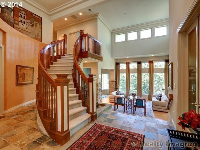 Traditional Staircase with Crown molding, Exposed beam, High ceiling, curved staircase, French doors, can lights