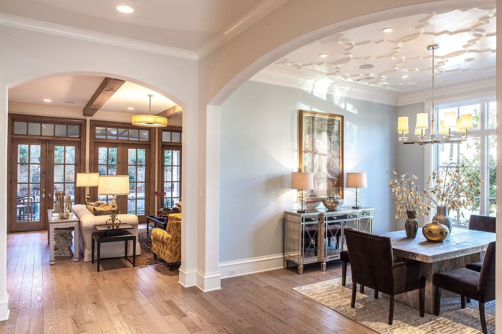 Contemporary Dining Room with Casement, Chandelier, Standard height, can lights, Hardwood floors, Crown molding
