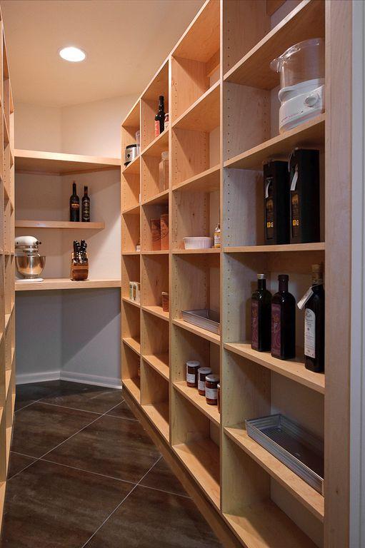 Modern Pantry with sandstone tile floors, Standard height, Built-in bookshelf, can lights, stone tile floors