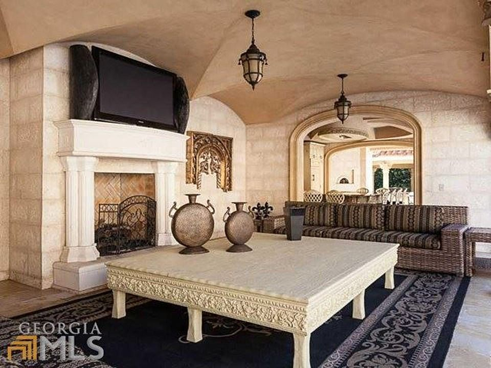 Mediterranean Living Room with Standard height, Pendant light, Fireplace, Cement fireplace, Concrete floors
