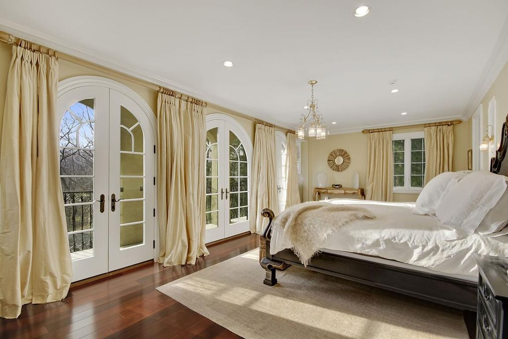 Traditional Master Bedroom with Wall sconce, Chandelier, can lights, Striated Flatweave Rug -Sant, Hardwood floors, Casement