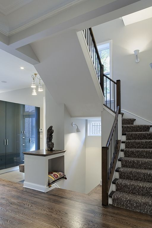 Modern Staircase with Crown molding, Wall sconce, curved staircase, Hardwood floors, Exposed beam, High ceiling