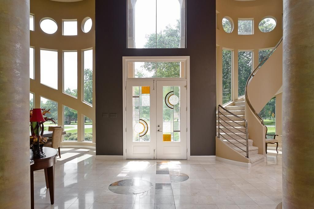 Contemporary Entryway With Stained Glass Door Amp French