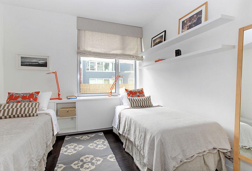 Contemporary Guest Bedroom with Hardwood floors, Built-in bookshelf, Casement, Standard height
