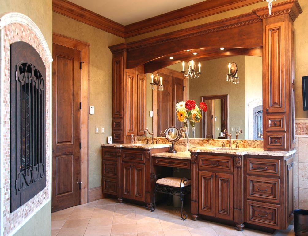 Traditional Master Bathroom with specialty door, Fireplace, Chandelier, Undermount sink, Raised panel, Standard height