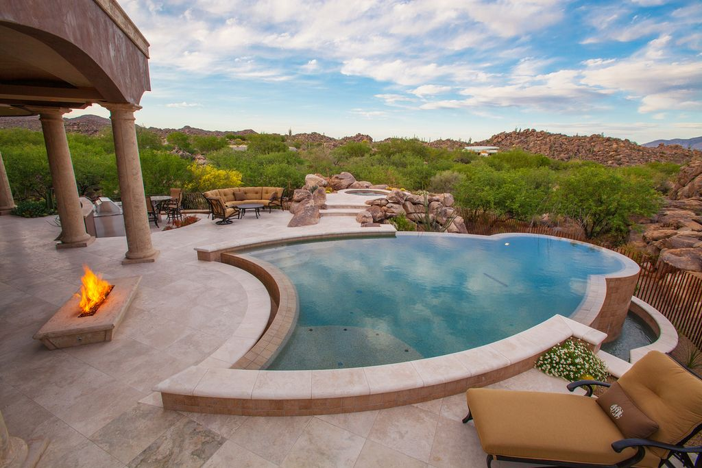 Mediterranean Swimming Pool with exterior stone floors, Fence, Fire pit, Pathway, Other Pool Type, Outdoor kitchen