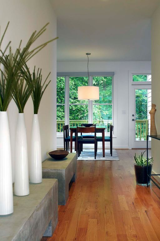 Contemporary Hallway with Pendant light, double-hung window, Hardwood floors, French doors, Standard height, Transom window
