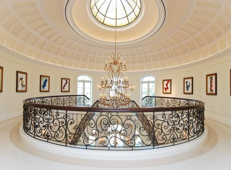 Traditional Staircase with Wall sconce, Double staircase, Cathedral ceiling, sandstone floors
