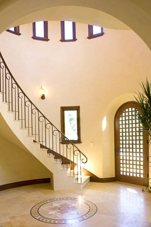 Mediterranean Entryway with picture window, Casement, High ceiling, simple marble floors, specialty door, Wall sconce