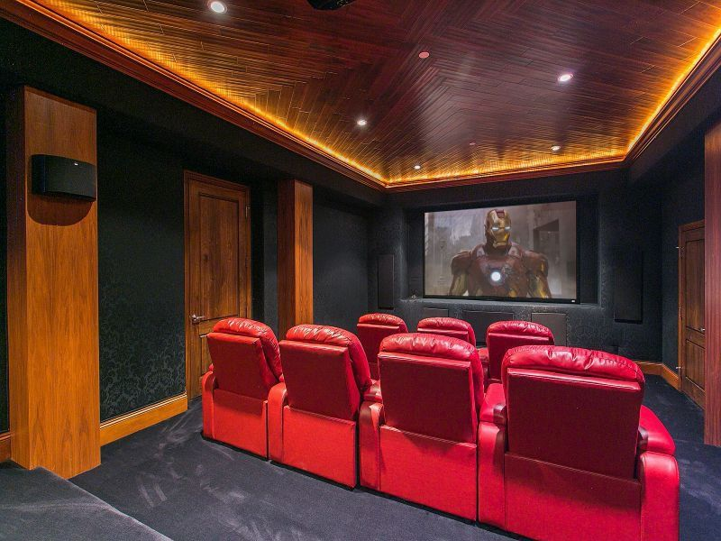 Craftsman Home Theater with interior wallpaper, Standard height, Carpet, Crown molding, specialty door, can lights