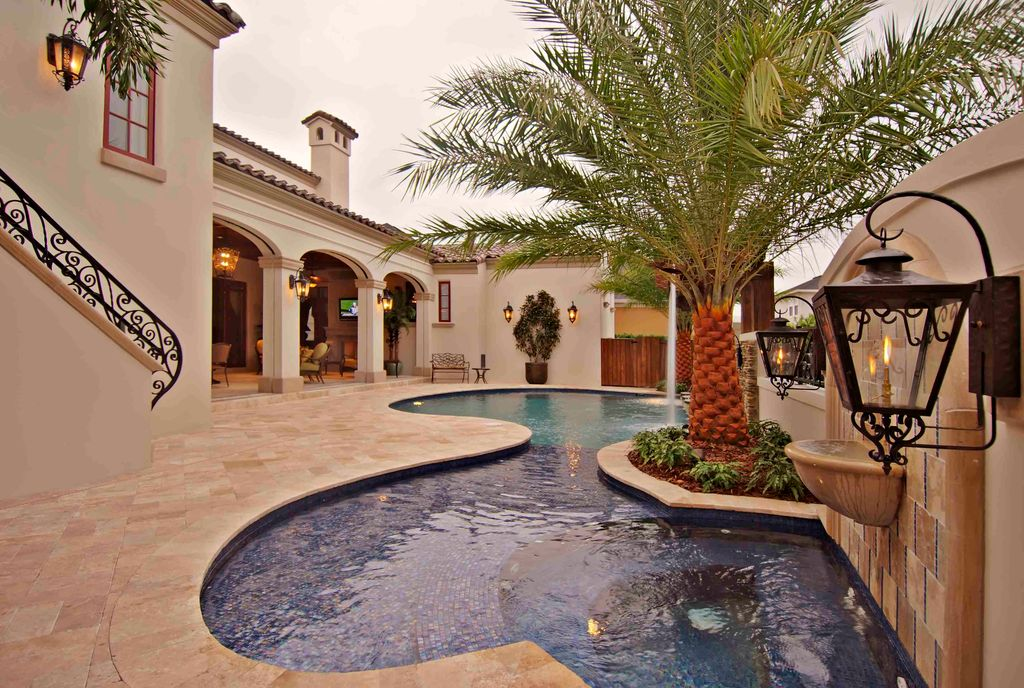 Mediterranean Swimming Pool with Other Pool Type, Pathway, Painted stucco exteriors, Casement, Fence, Bird bath, Fountain