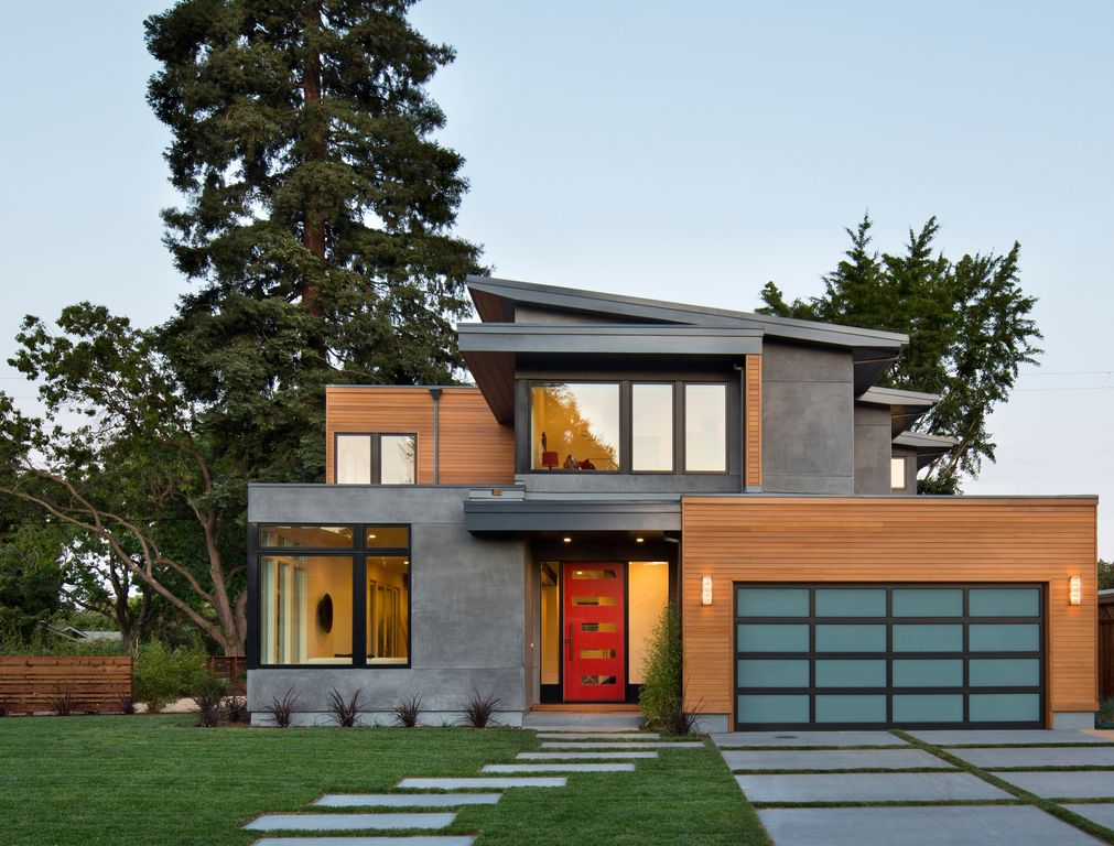 contemporary exterior of home with bp glass garage door cedar siding