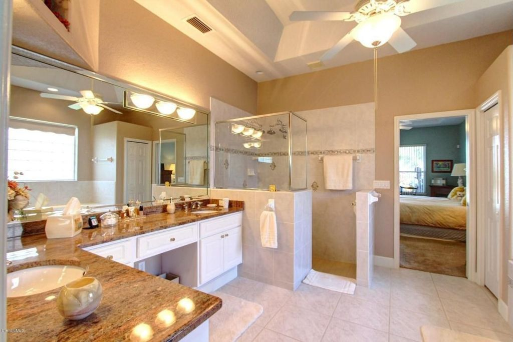 Traditional Master Bathroom with Complex granite counters, six panel door, Wall Tiles, Undermount sink, can lights, Flush