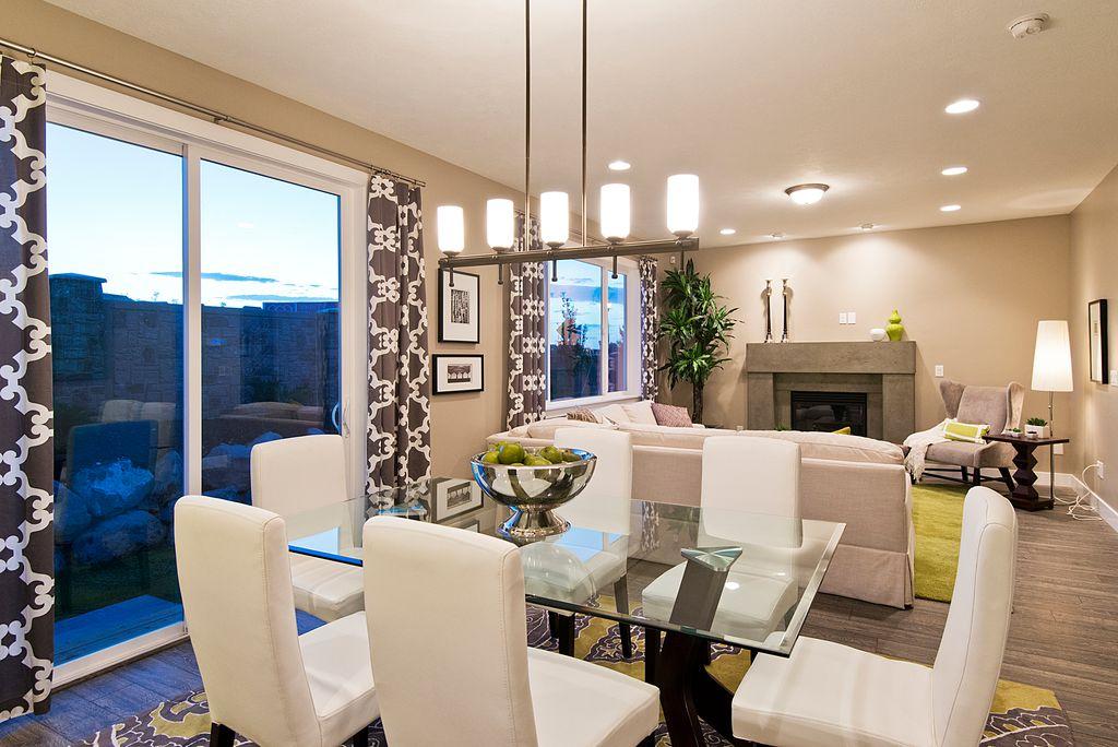 Contemporary Dining Room with sliding glass door, Chandelier, Hardwood floors, Standard height