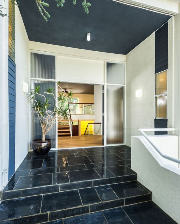 Contemporary Entryway with specialty window, flush light, stone tile floors, Wall sconce, soapstone tile floors, French doors