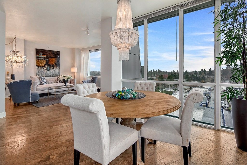 Contemporary Great Room with picture window, flush light, Standard height, Hardwood floors, Chandelier