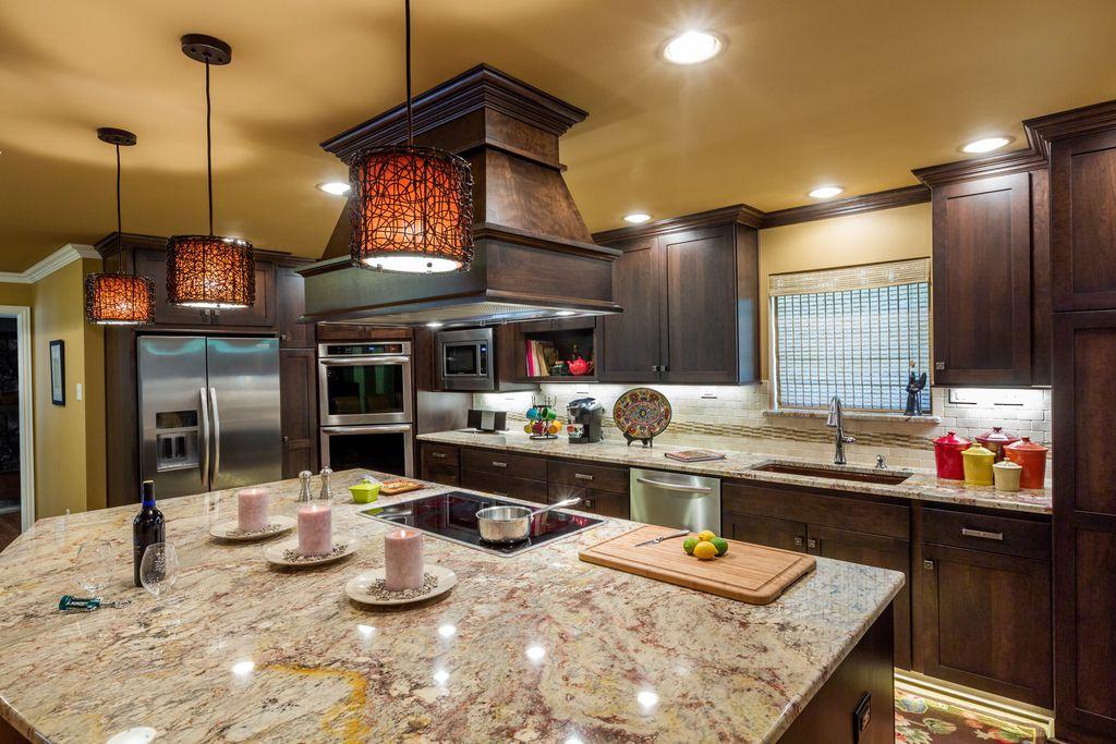 Craftsman Kitchen with flush light, Undermount sink, Built In Refrigerator, Complex granite counters, Kitchen island, Paint