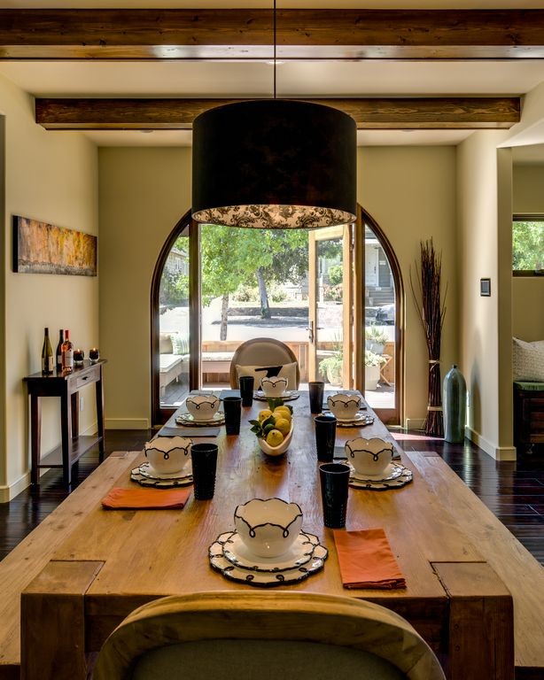 Contemporary Dining Room with French doors, Pendant light, Exposed beam, Hardwood floors, Standard height