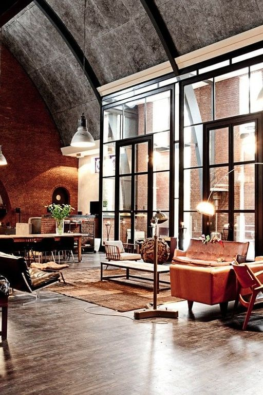 Contemporary Great Room with Transom window, French doors, High ceiling, interior brick, brick fireplace, Exposed beam