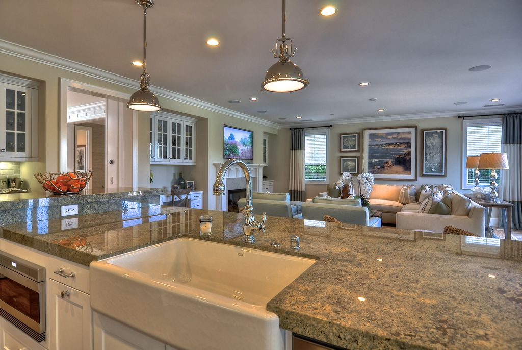 Traditional Great Room with Built-in bookshelf, Pental Custom African Ivory Polished Granite, Crown molding, stone fireplace
