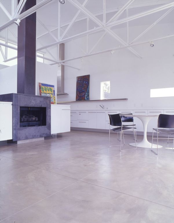 Contemporary Great Room with Cathedral ceiling, Wood Stove fireplace, Exposed beam, Concrete floors, Fireplace, can lights