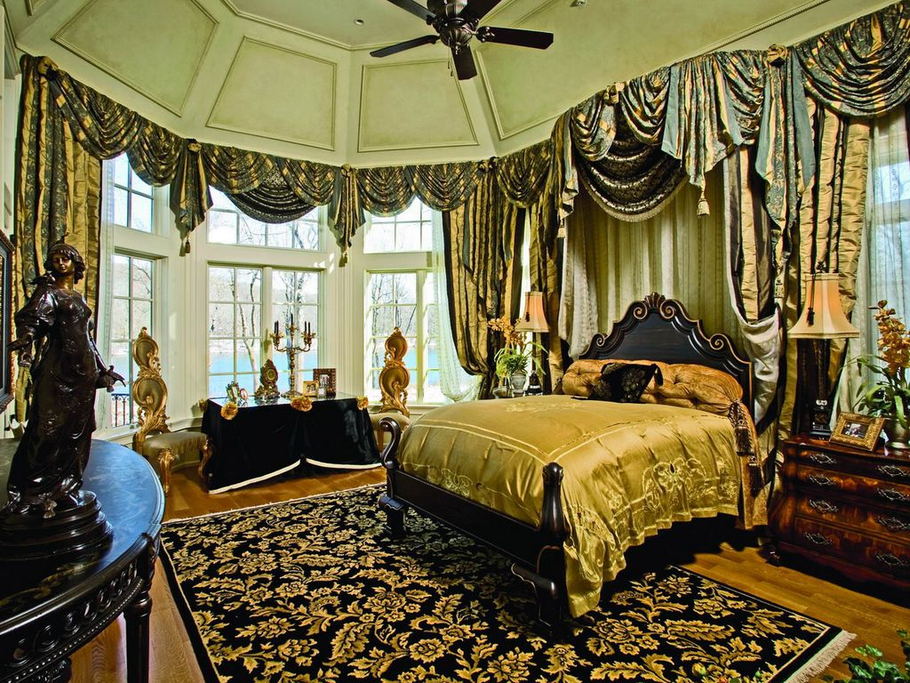 Traditional Master Bedroom with High ceiling, Hardwood floors, Ceiling fan