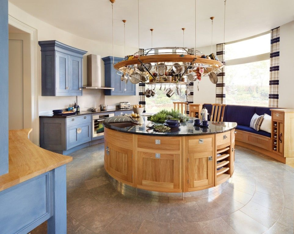 Craftsman Kitchen with wall oven, Knotty pine cabinets, Pendant light, One-wall, custom design Pot Rack, Wall Hood, Flush