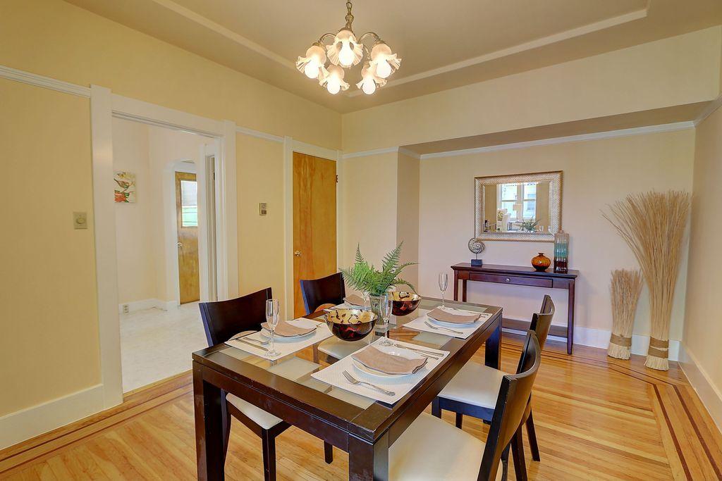 Traditional Dining Room with Hardwood floors, flat door, Standard height, Chandelier
