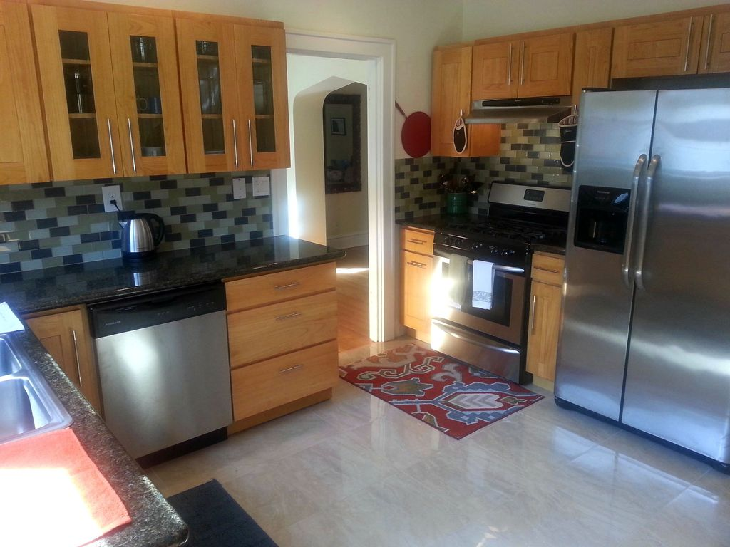 Contemporary Kitchen with Ms international - black galaxy, Ceramic Tile, gas range, dishwasher, Wall Hood, Inset cabinets