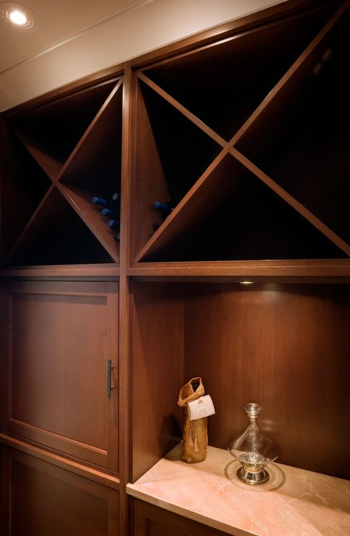 Contemporary Wine Cellar with Crown molding, Standard height, can lights