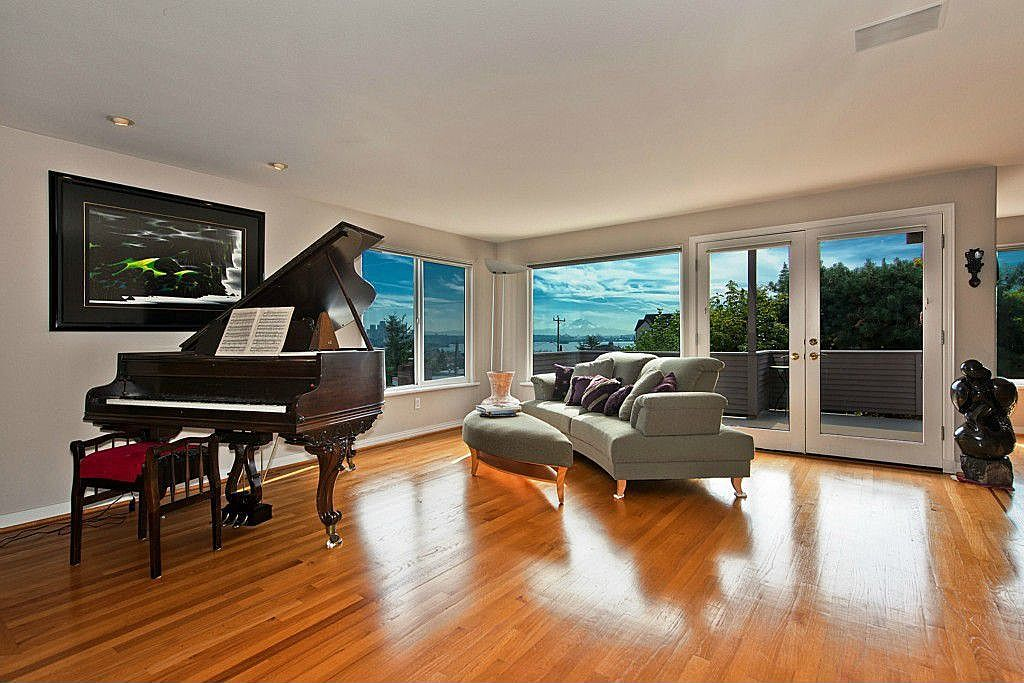 Contemporary Living Room with Hardwood floors, French doors, Wall sconce