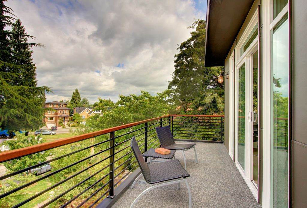 Contemporary Deck with exterior concrete tile floors, Deck Railing, Transom window, picture window, Fence, sliding glass door