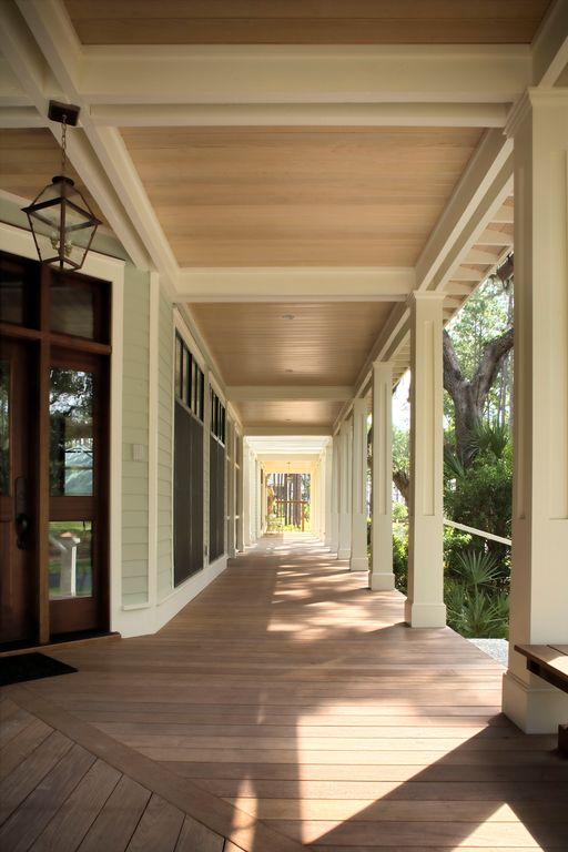 Traditional Porch with Transom window, Glass panel door, picture window, Wrap around porch